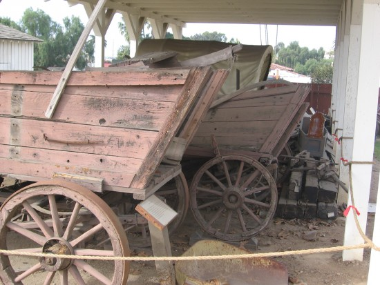 Several unrestored wagons.
