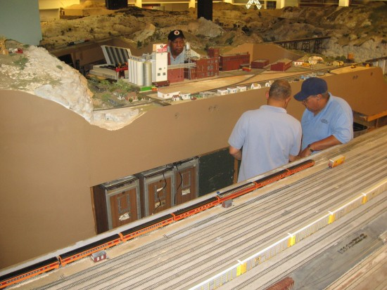 Men work on unfinished San Diego and Arizona Eastern exhibit.