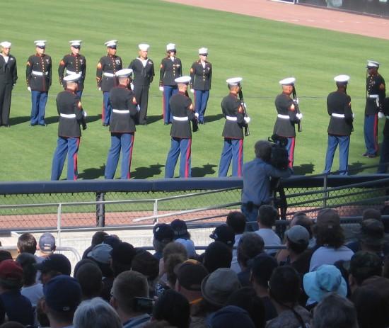 Marines fire guns to salute a true hero.