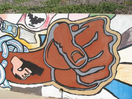 11 Mural behind Chicano Park basketball court.