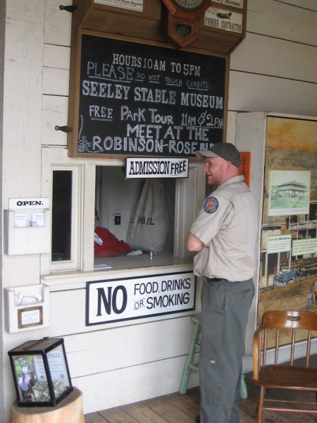 Old Town San Diego park ranger chats with ticket window lady.