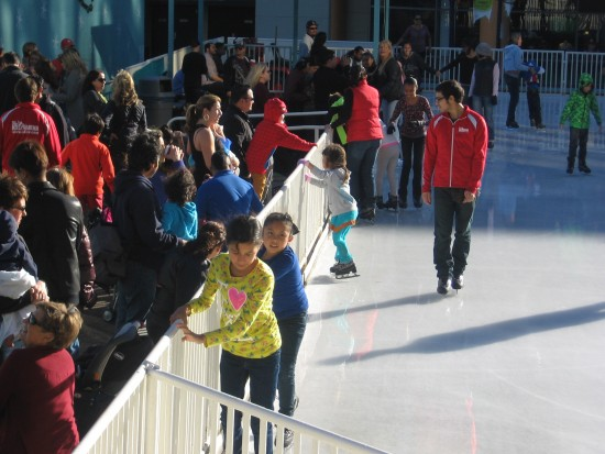 Beginning ice skaters hang on for dear life!