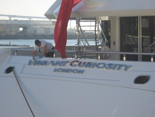 Crew member polishes Vibrant Curiosity.