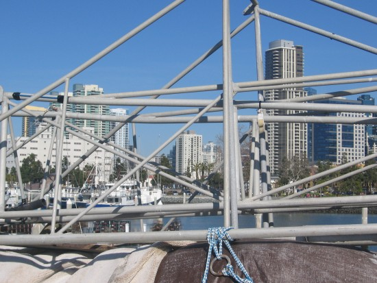 Detached boat structure on pier frames San Diego skyscrapers.