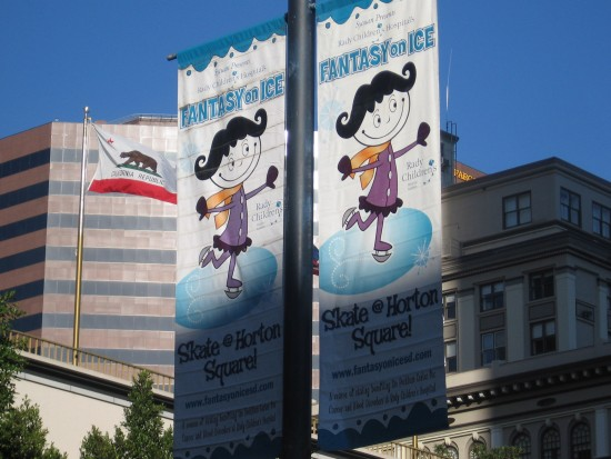 Fantasy on Ice banners hang along Broadway.