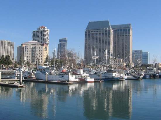 Fishing boats in Tuna Harbor and downtown skyscrapers.