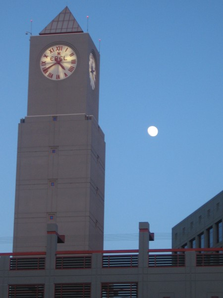 Full moon rises behind clock tower at 12th and Imperial Transit Center.
