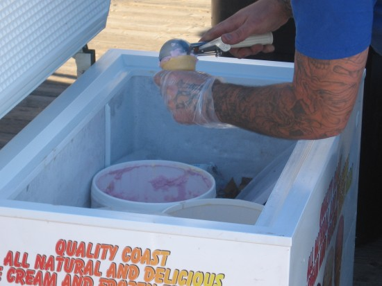 Ice cream vendor near USS Midway scoops New Year's Day treat.