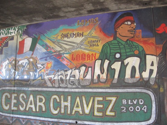 Cesar Chavez Blvd mural under busy freeway.