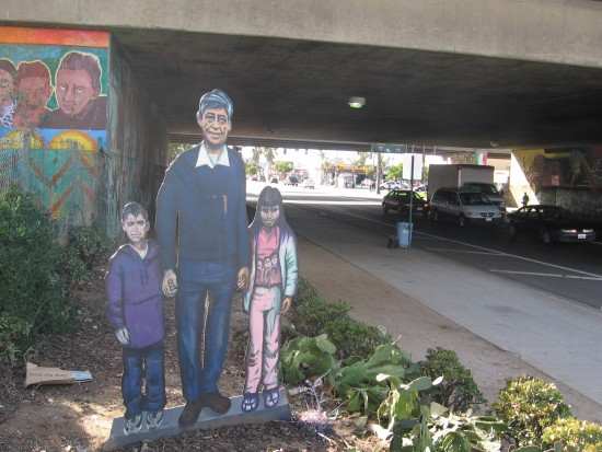 Painted family greets traffic in Barrio Logan.