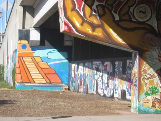 Painted images on Interstate 5 north of Chicano Park.