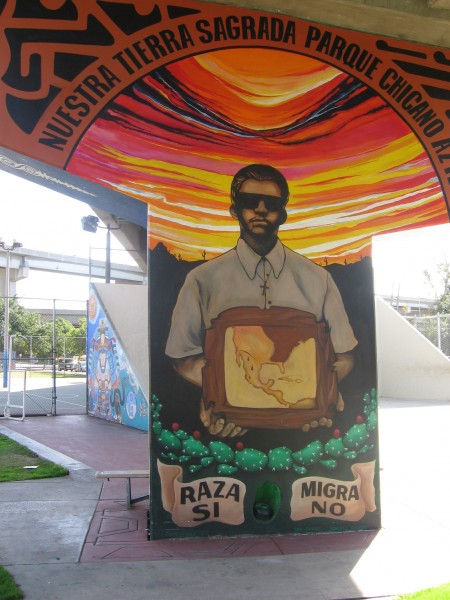 Mural supports Race, opposes the Border Patrol.
