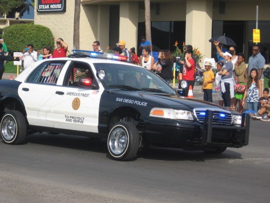 A cool police car fitted with hydraulics.