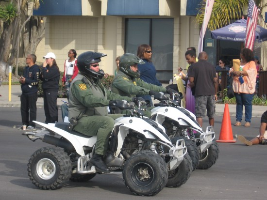 Border Patrol agents on all-terrain vehicles.