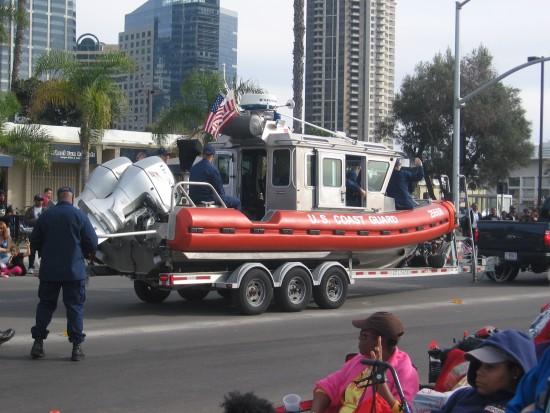 Coast Guard patrol boat towed along parade route.