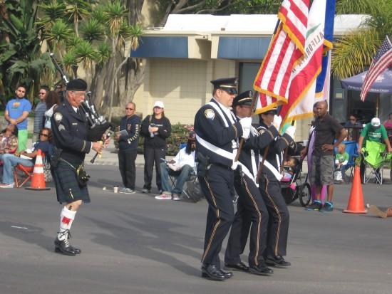 Patriotic colors precede bagpipes.