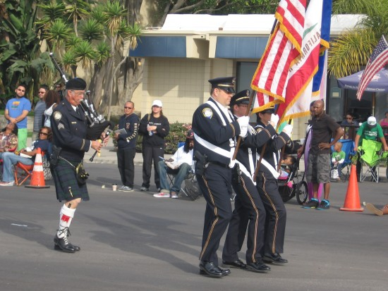 Patriotic colors precede bagpipes.