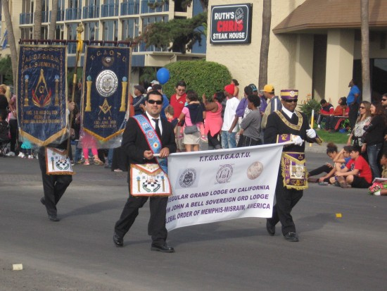 Members of a lodge parade on by to loud cheers.