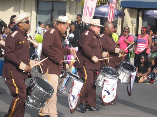 Drummers perform with pride on parade route.