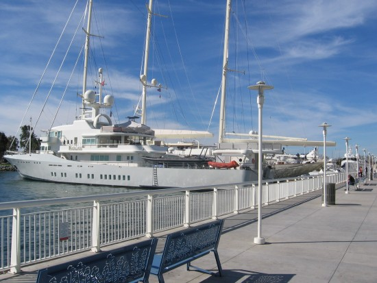 Large yachts docked behind convention center.