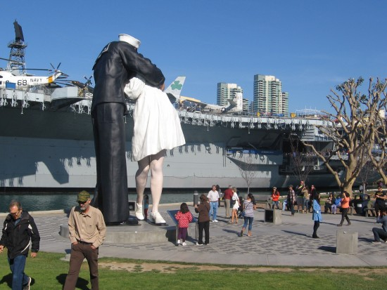 People gather about Seward Johnson's Unconditional Surrender.