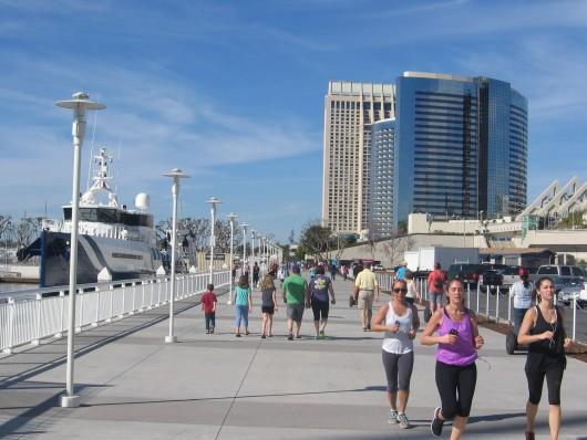 People walk and jog along the south Embarcadero.