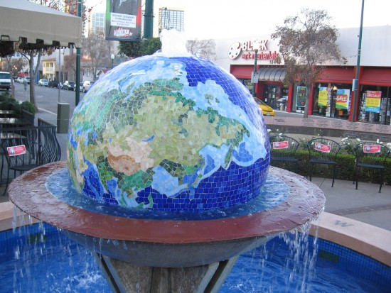Planet Earth globe fountain in Little Italy's Piazza Basilone.