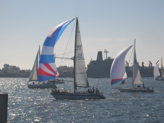 Sailboats and a Navy oiler docked at North Island in the background.