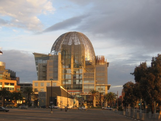 San Diego Central Library dome gilded by rising sun.