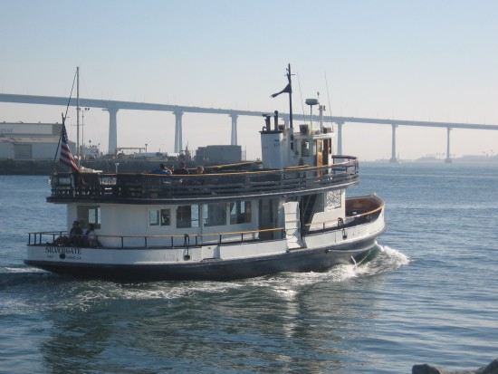 Silvergate ferry leaves for Coronado with bay bridge in background.