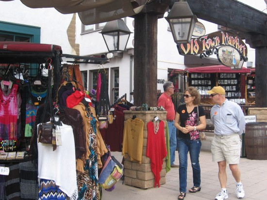 Tourists take a stroll through the colorful Old Town Market.