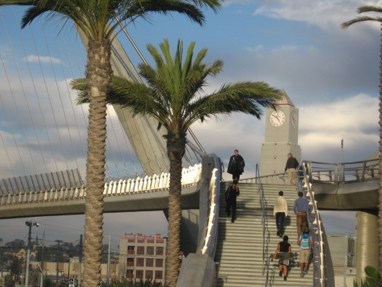 Bridge over Harbor Drive shines silver as folks ascend.