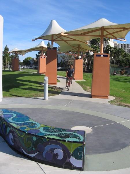 Bicyclist rides through San Diego's Cancer Survivors Park.