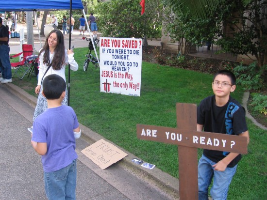 Child asks passersby if they are ready for death.