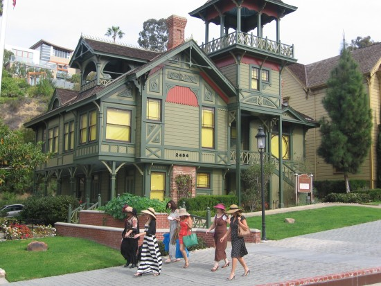 Group of ladies walking past the Sherman Gilbert House.
