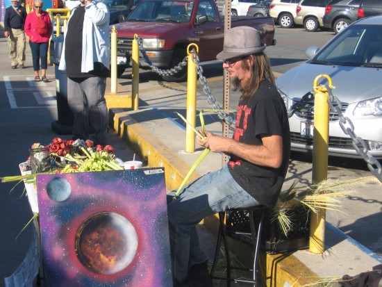 Artist sells space art and handmade crafts on the Embarcadero.