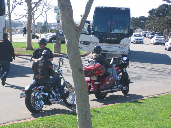 Bikers and tour bus in parking lot on Embarcadero.