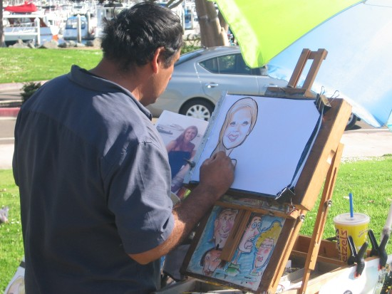 Caricature artist at work on a sunny San Diego day.