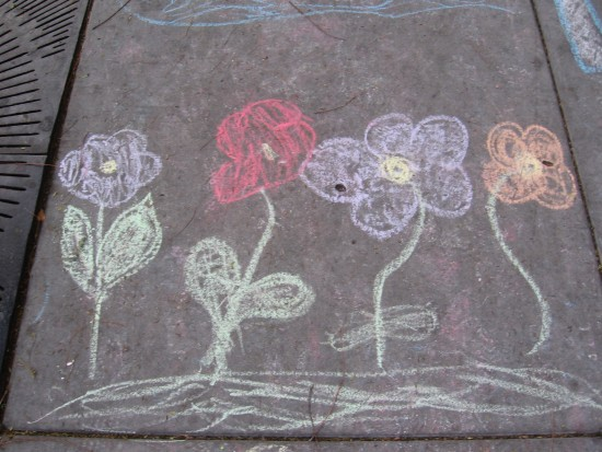 Chalk flowers on sidewalk.