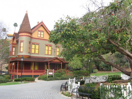 Christian House, built in 1889, seen beyond large tree.