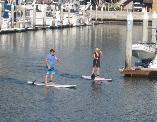 Couple paddling boards in Marriott Marina.