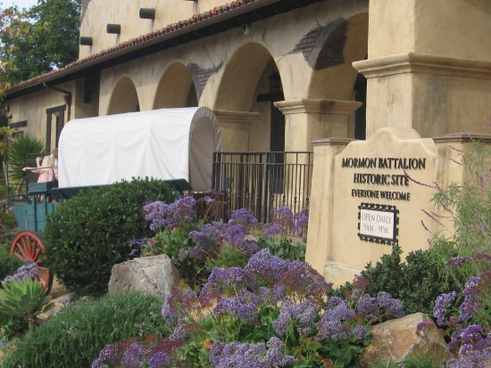 Covered wagon in front of Mormon Battalion Historic Site.