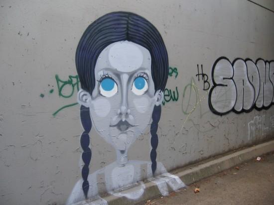 Elegant street art found on Highway 163 underpass wall.