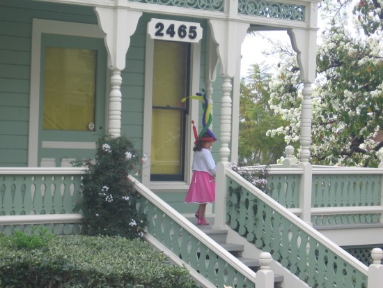 Girl on porch of the classic revival Burton House.