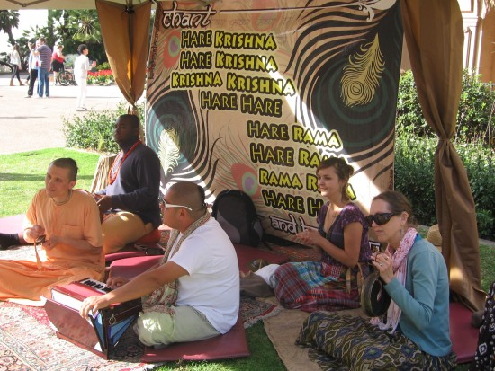 Hare Krishna advocates sit chanting their mantra.