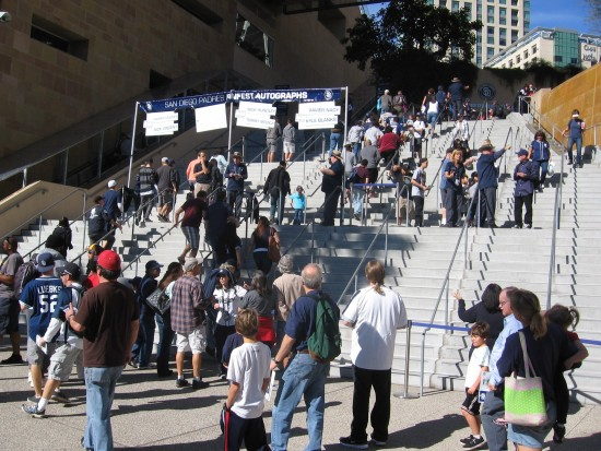 Padres fans stream up the stairs at Petco Park.