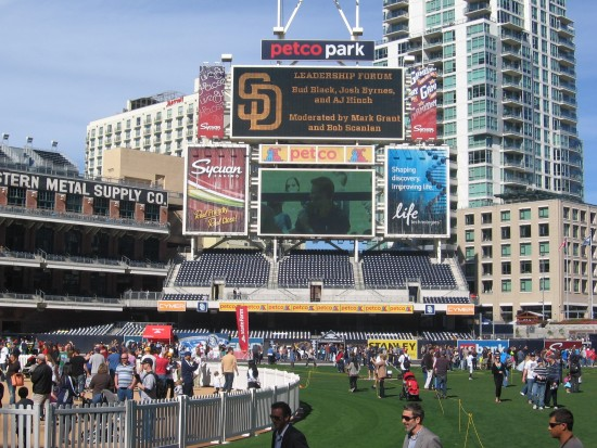 People enjoy themselves on the baseball field at Padres Fanfest.
