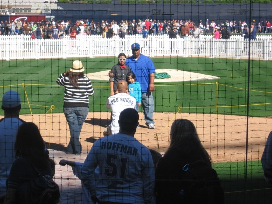 Posing for photos at home plate at Padres Fanfest.