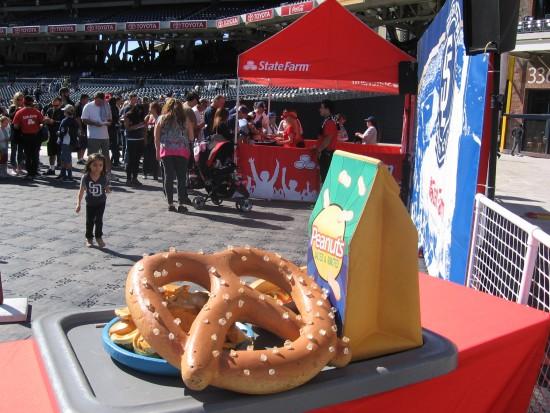 Small girl heads toward a big pretzel.