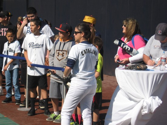 Fans wait in line to field balls in Petco's outfield.